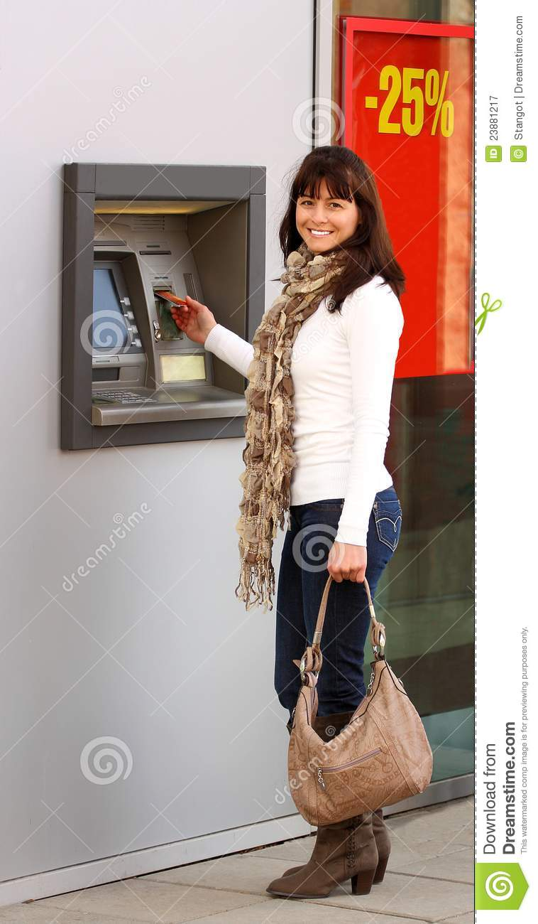 Woman Using An Atm Royalty Free Stock Photography - Image -7468