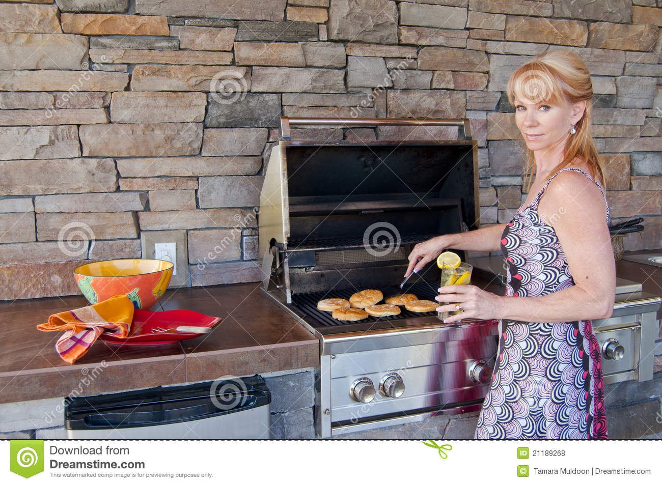 Woman using barbeque grill