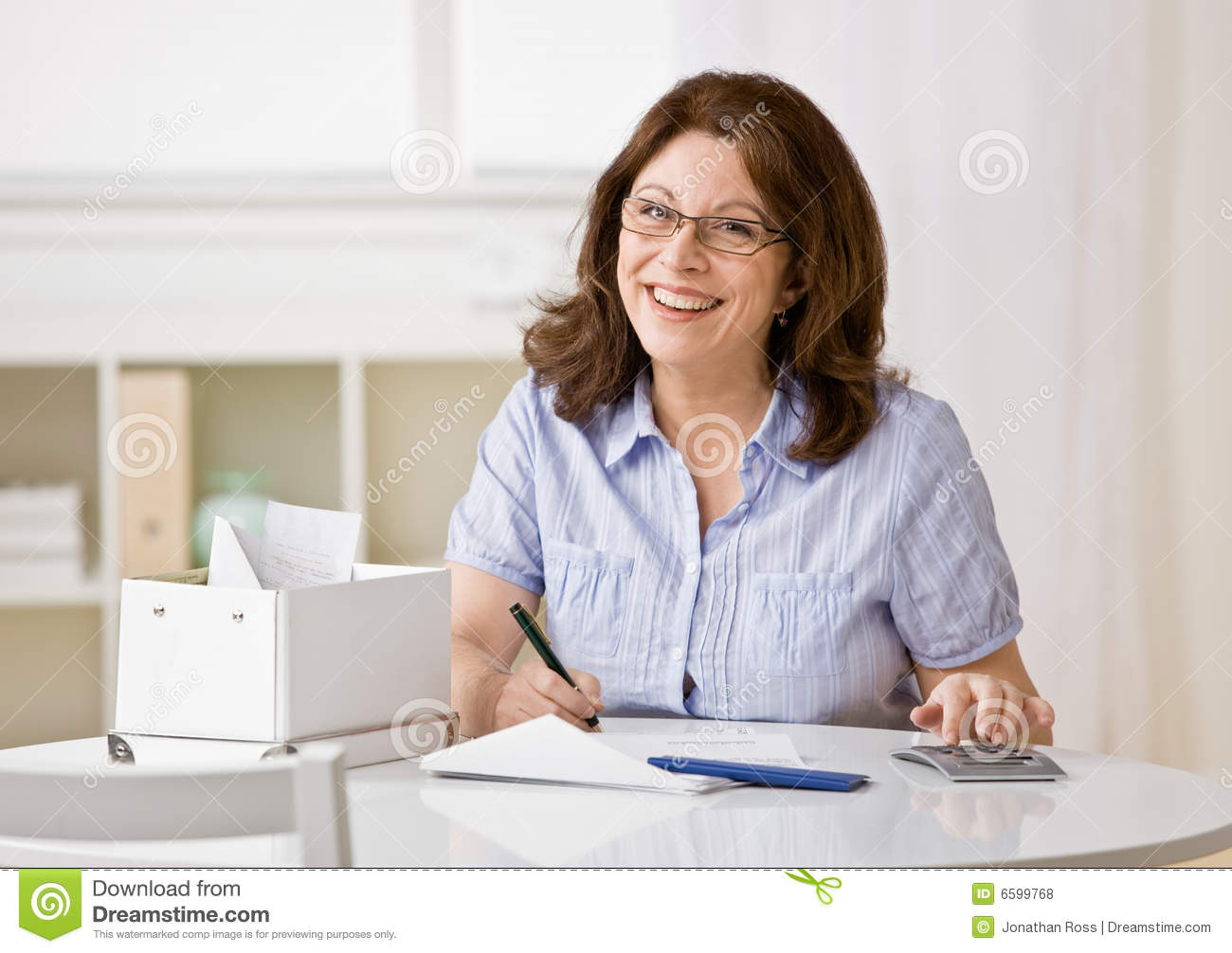 woman using calculator to pay monthly bills royalty free