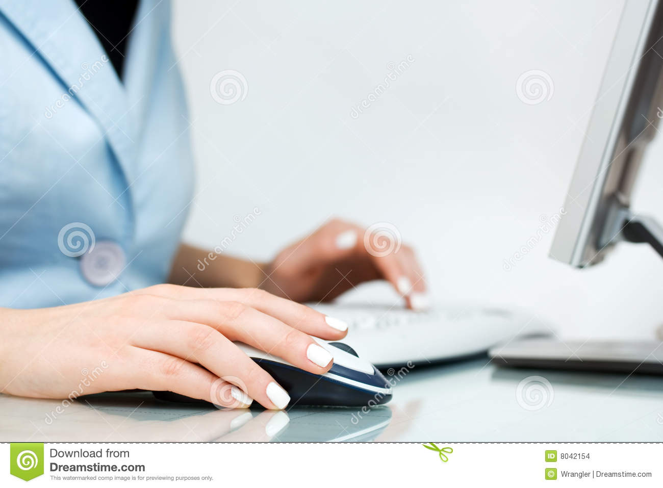 Woman using computer mouse and keyboard