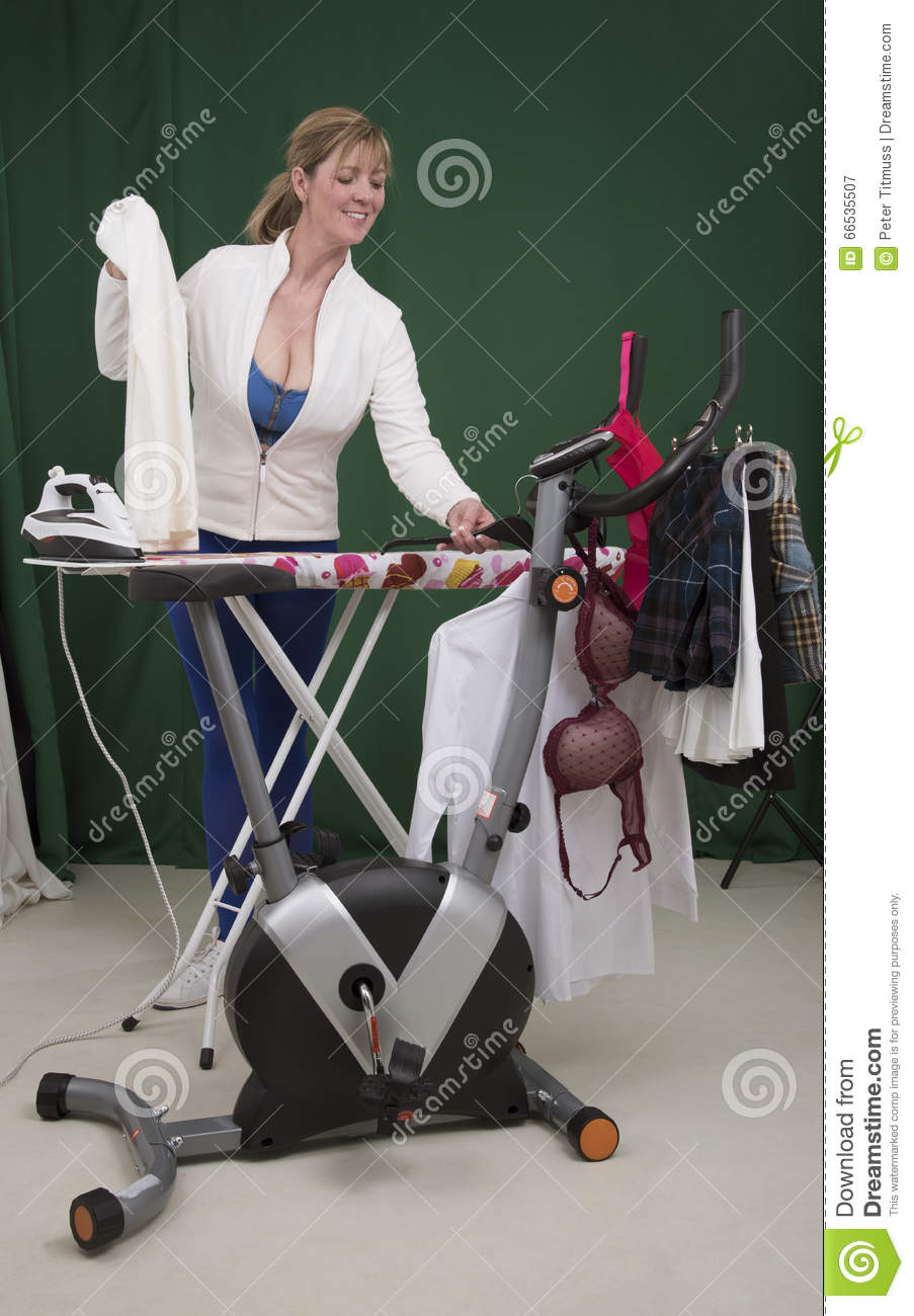 Woman Using Exercise Bike For Hanging Clothing Stock Photo Image