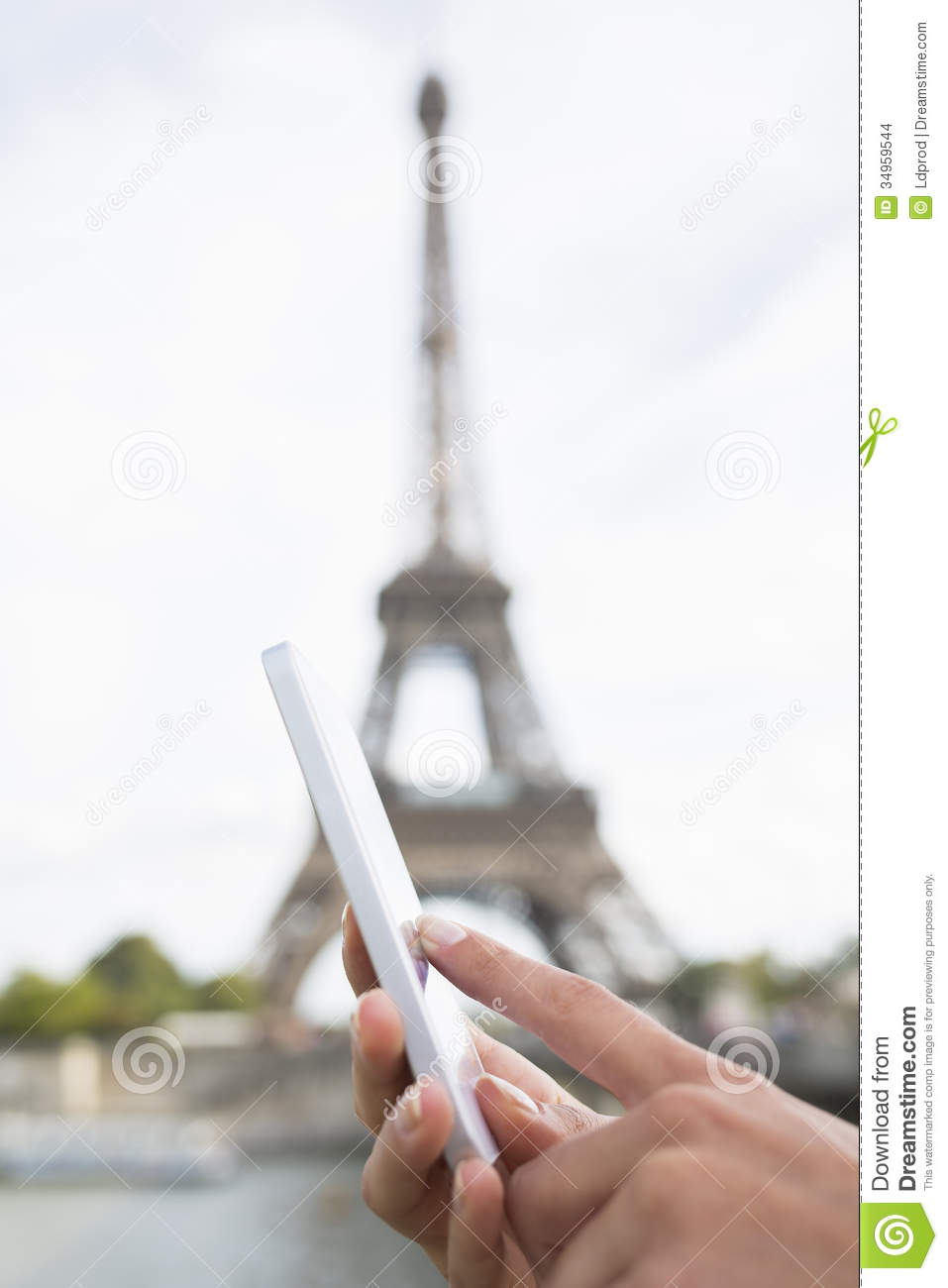woman using her cell phone background eiffel tower stock photo image of person people 34959544. Black Bedroom Furniture Sets. Home Design Ideas