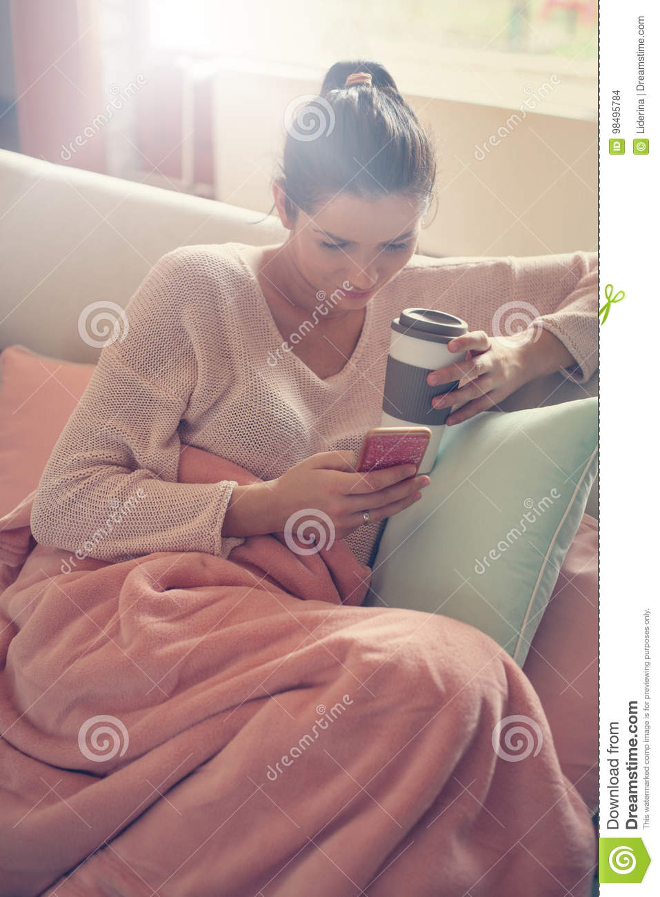 Woman using a mobile phone at home.