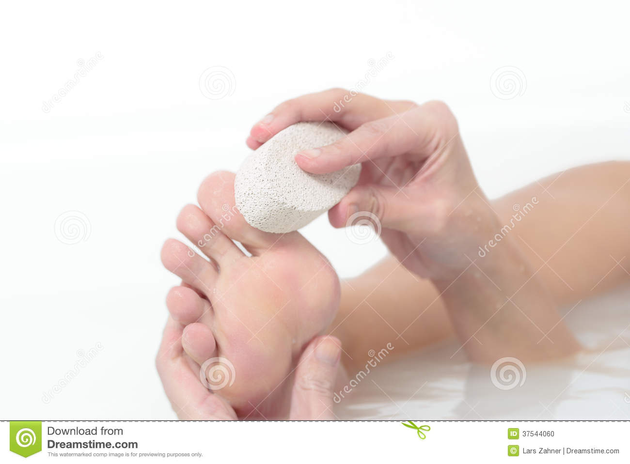 Woman Using A Pumice Stone To Exfoliate Her Feet Stock Photo Woman Using A  Pumice Stone