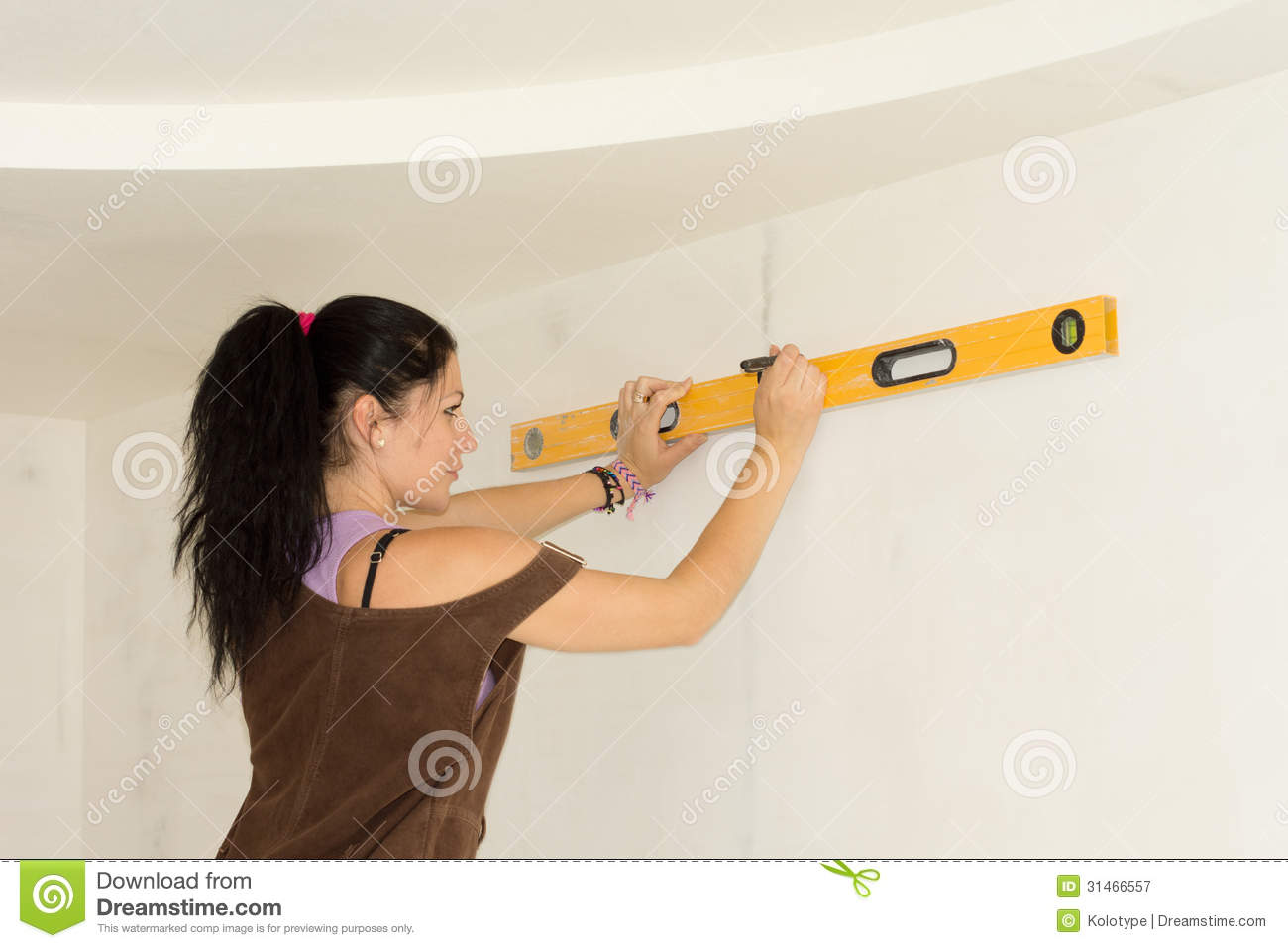 Woman using spirit level to work out measurements