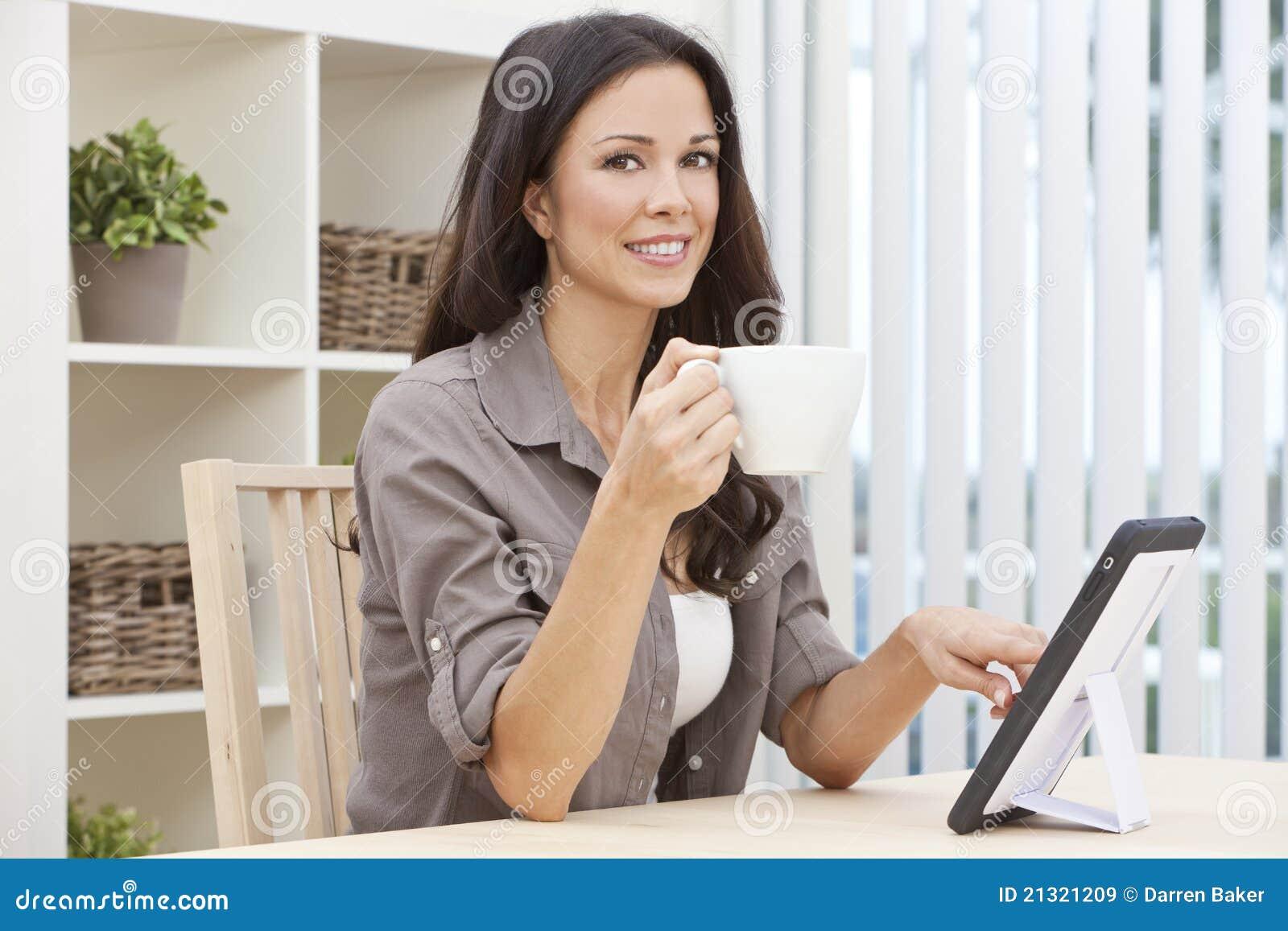 Woman Using Tablet Computer Drinking Tea Coffee