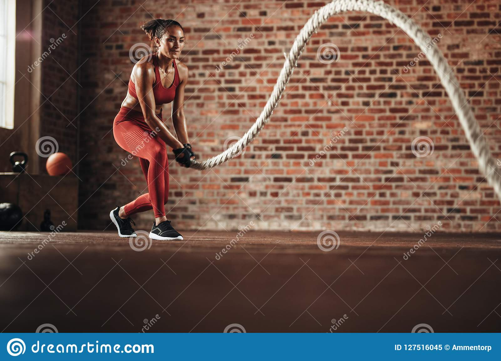 Woman doing cross training routine