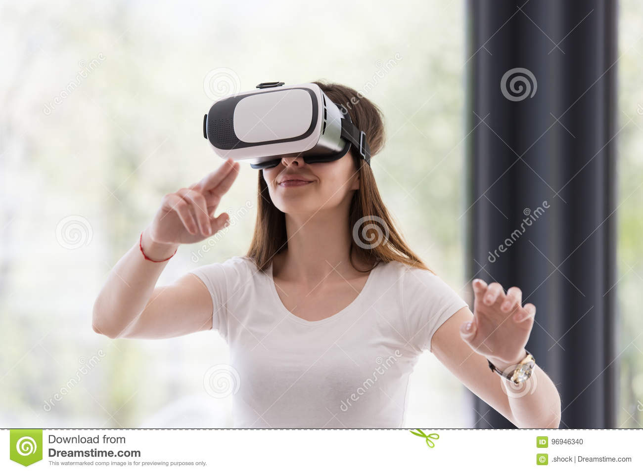 Young Woman Using A Virtual Reality Headset With