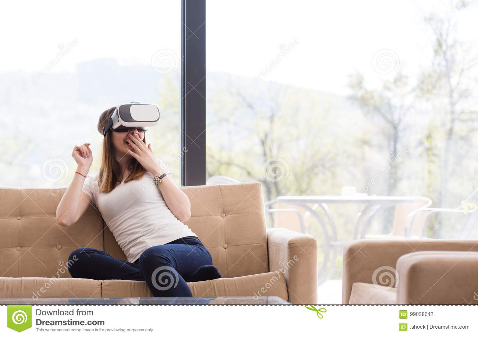 Woman Wearing Virtual Reality Glasses. Smartphone Using