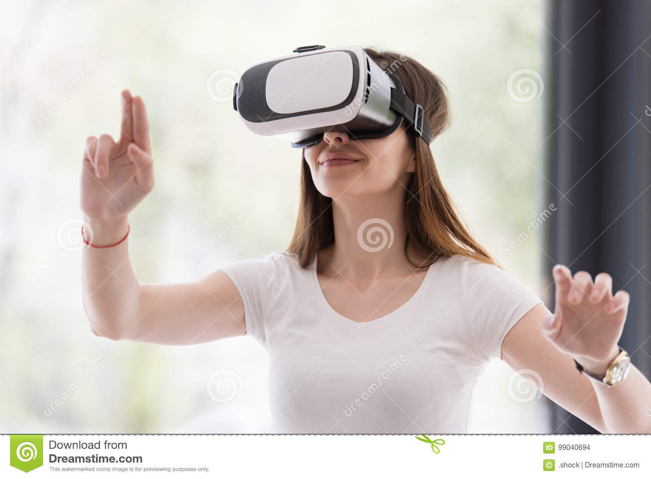 cdd744d837af Smile happy woman getting experience using VR-headset glasses of virtual  reality at home