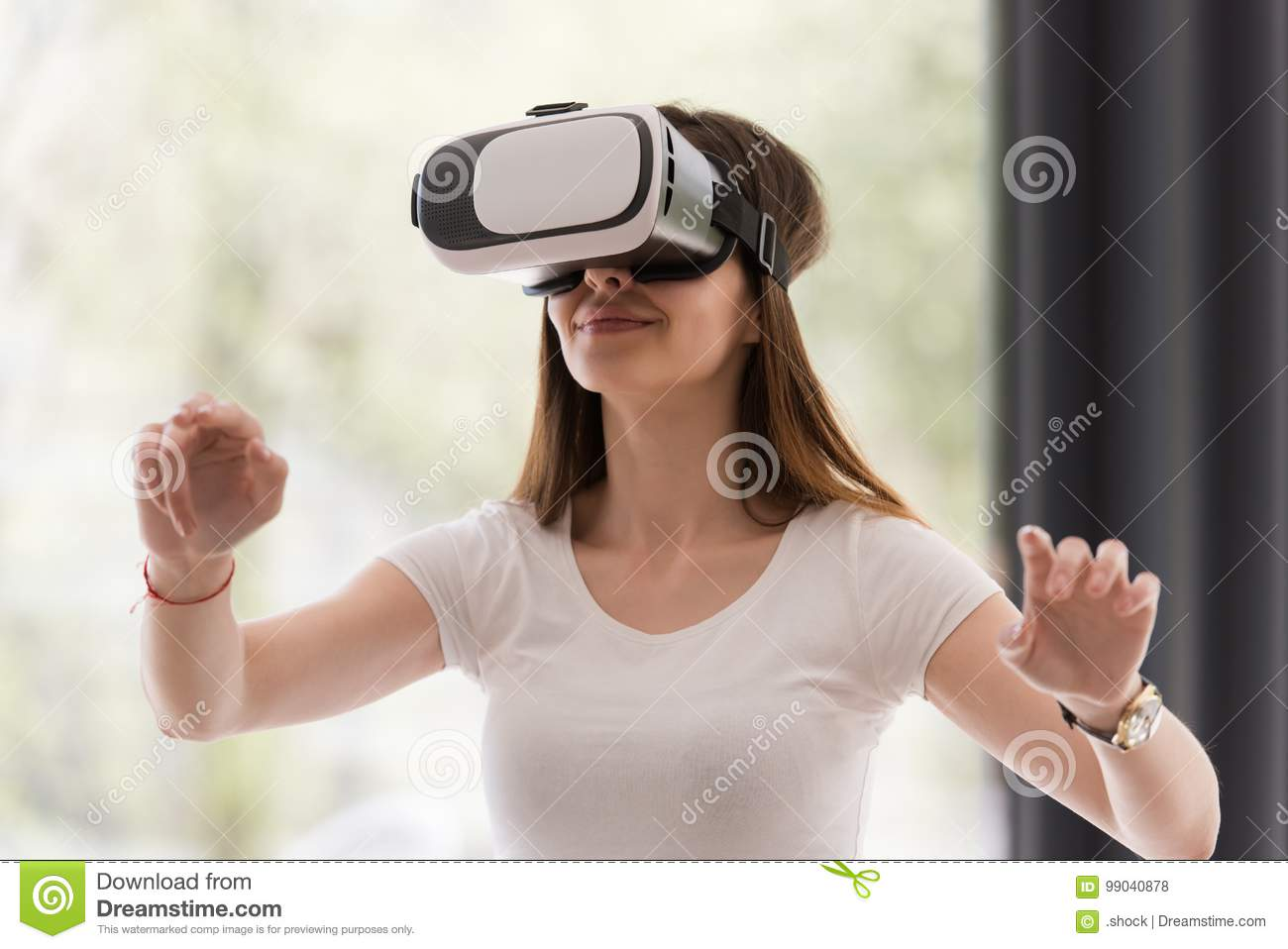 bfc15420ebbc Smile happy woman getting experience using VR-headset glasses of virtual  reality at home