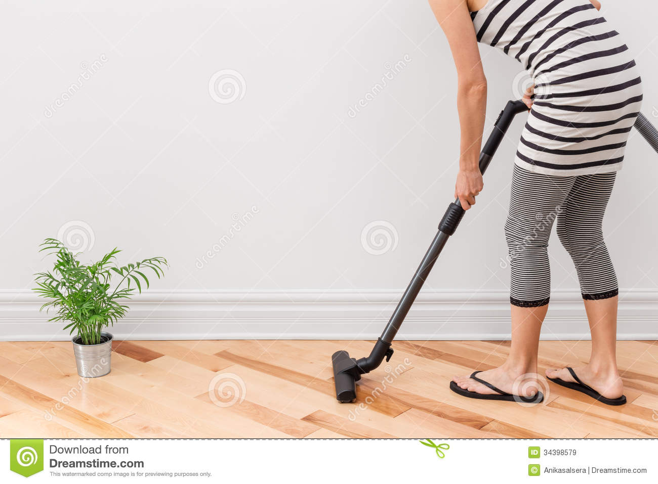 woman vacuum cleaning the room royalty free stock images