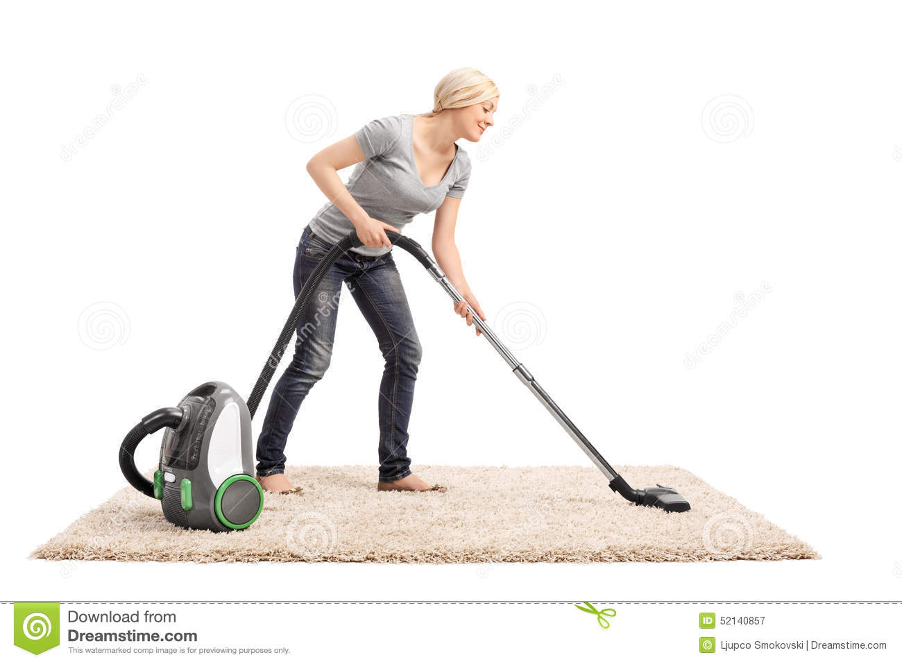 Woman Vacuuming A Carpet With Vacuum Cleaner Stock Image
