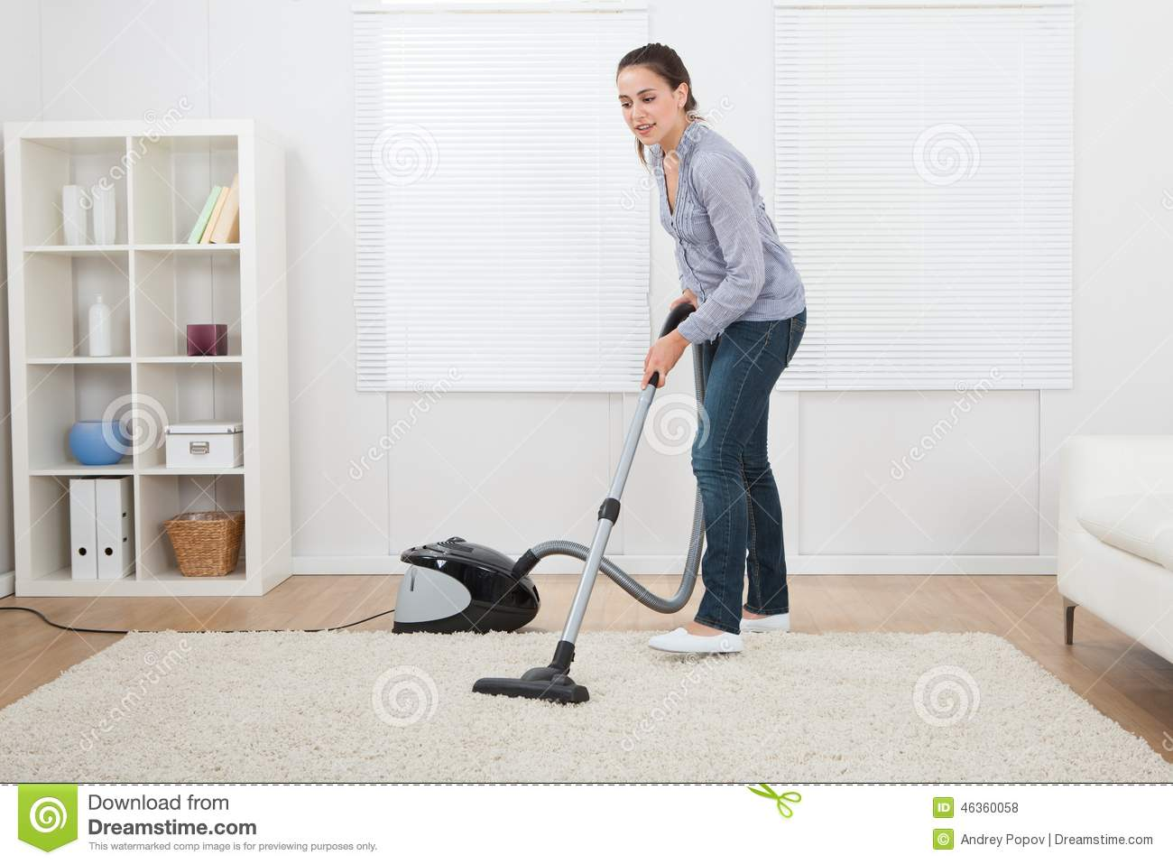 woman vacuuming rug at home stock photo image 46360058. Black Bedroom Furniture Sets. Home Design Ideas