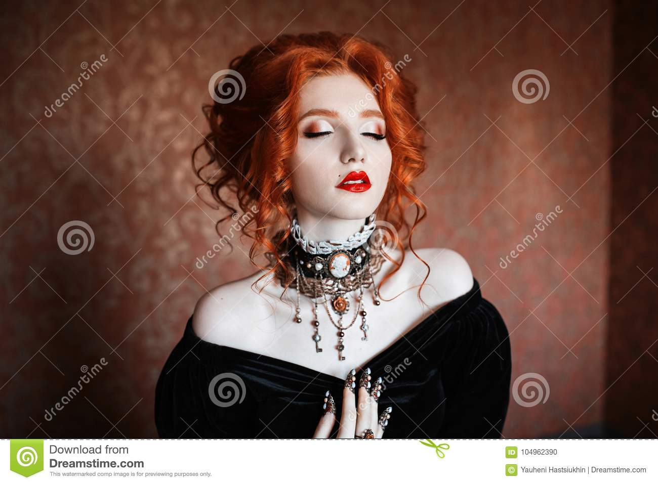 39264f04511 A woman is a vampire with pale skin and red hair in a black dress and a  necklace on her neck.