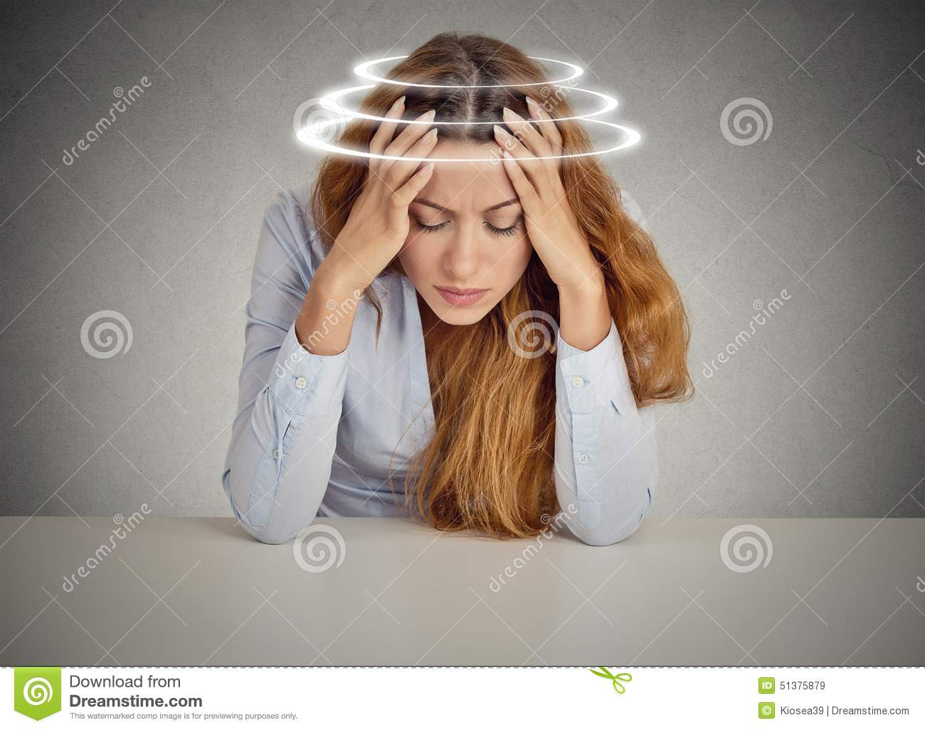 Woman with vertigo. Young female patient suffering from dizziness