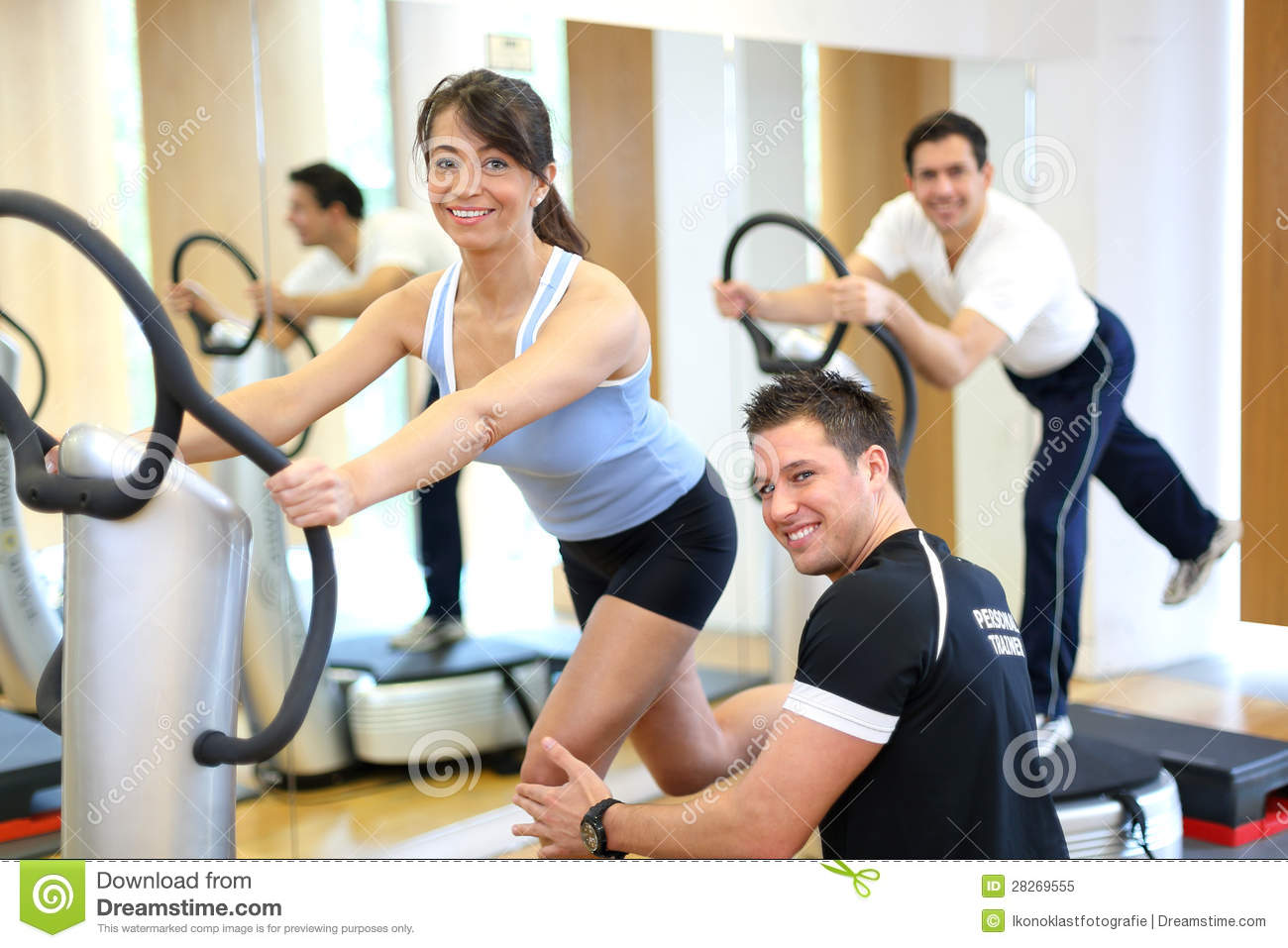 Woman On Vibration Plate Instructed By Her Trainer Stock