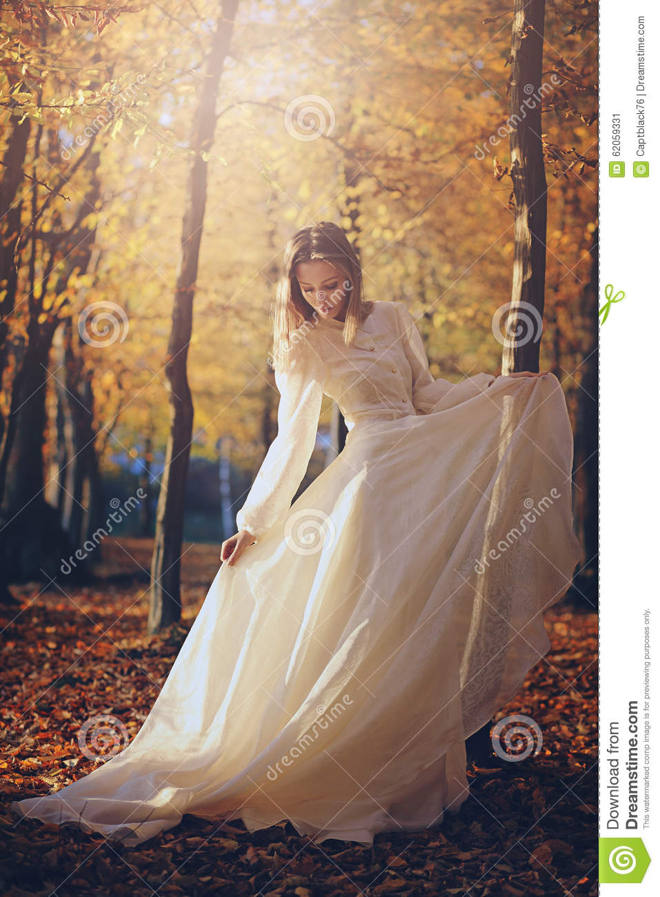 Woman With Victorian Dress In Autumn Woods Stock Photo