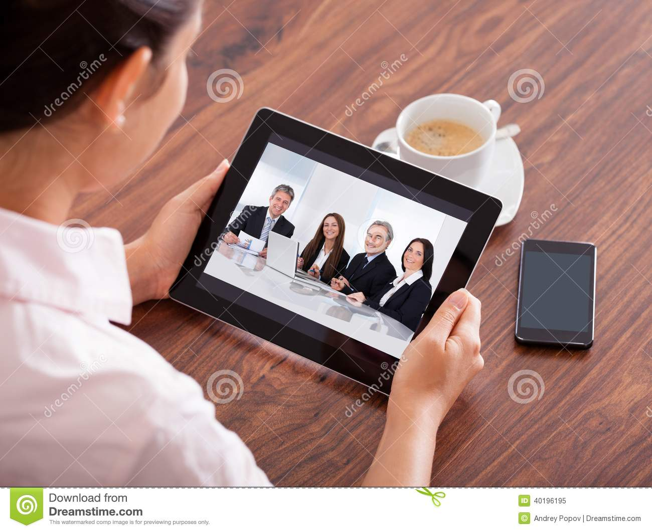 Woman video conferencing on digital table
