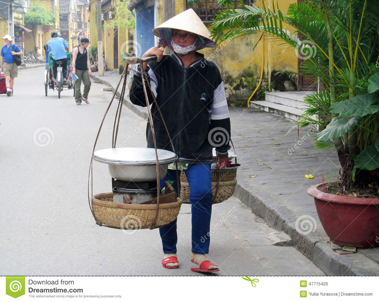 ca57c2b9e6d Women wearing traditional asian hats made of straw or palm leaves cones and  bandages on face. On the streets of the city are working in Vietnam