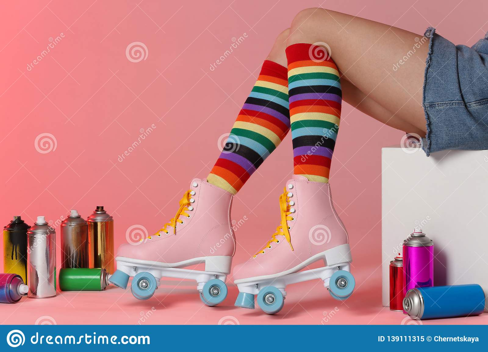 Woman With Vintage Roller Skates And Spray Paint Cans On