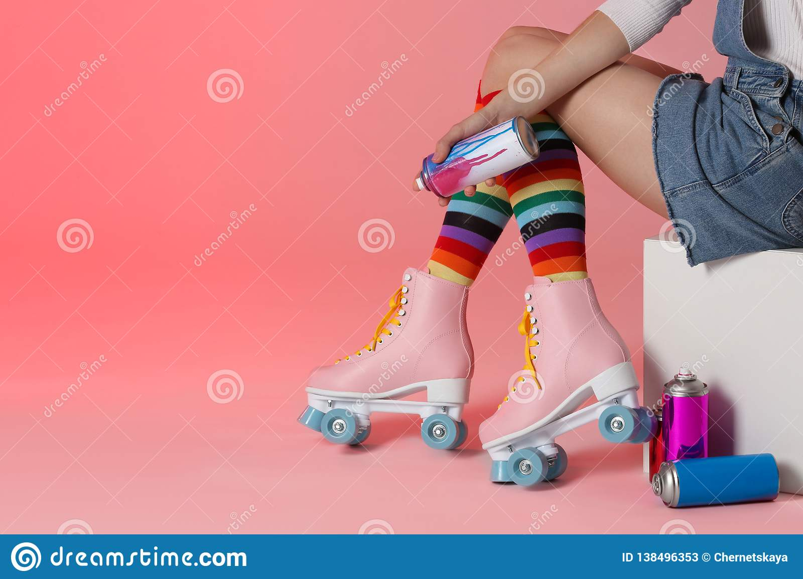 Woman With Vintage Roller Skates And Spray Paint Cans Stock Image Image Of Paint Pink 138496353