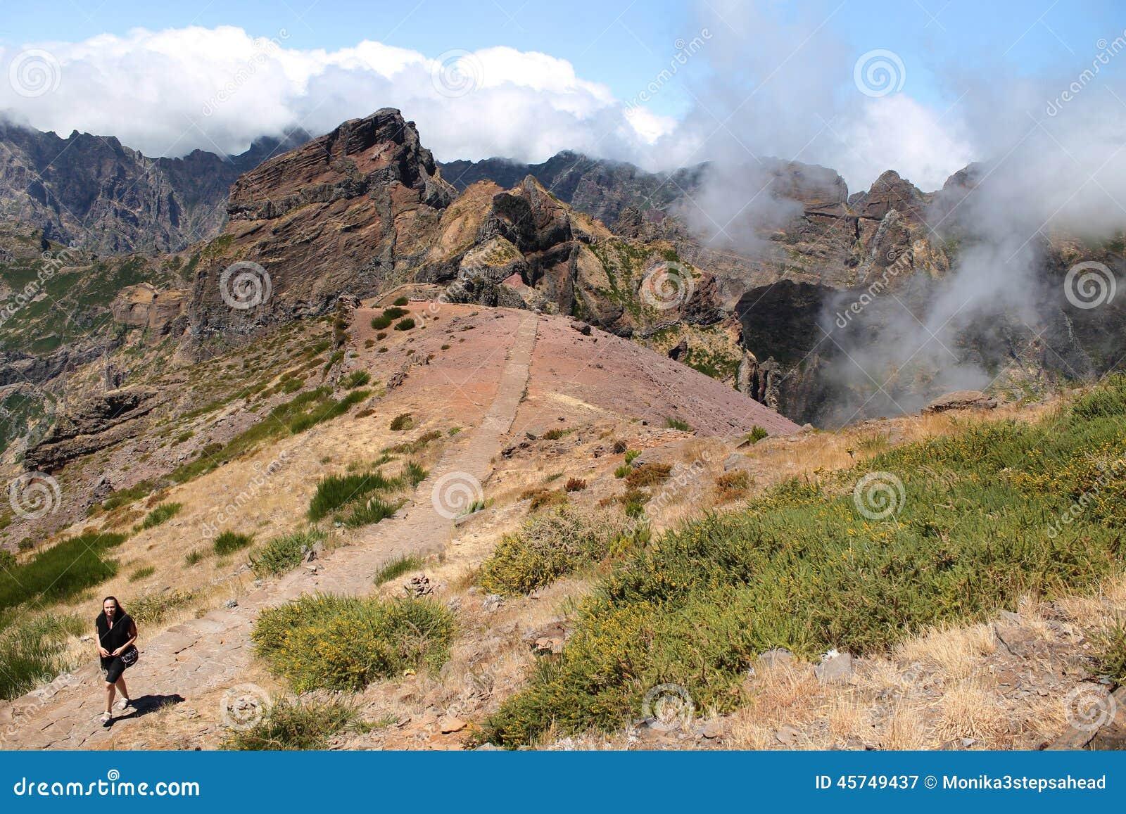 Woman walking alone in mountains