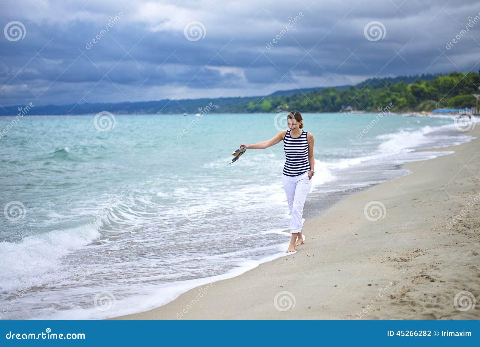 Woman walking on the beach stock photo. Image of enjoy ...