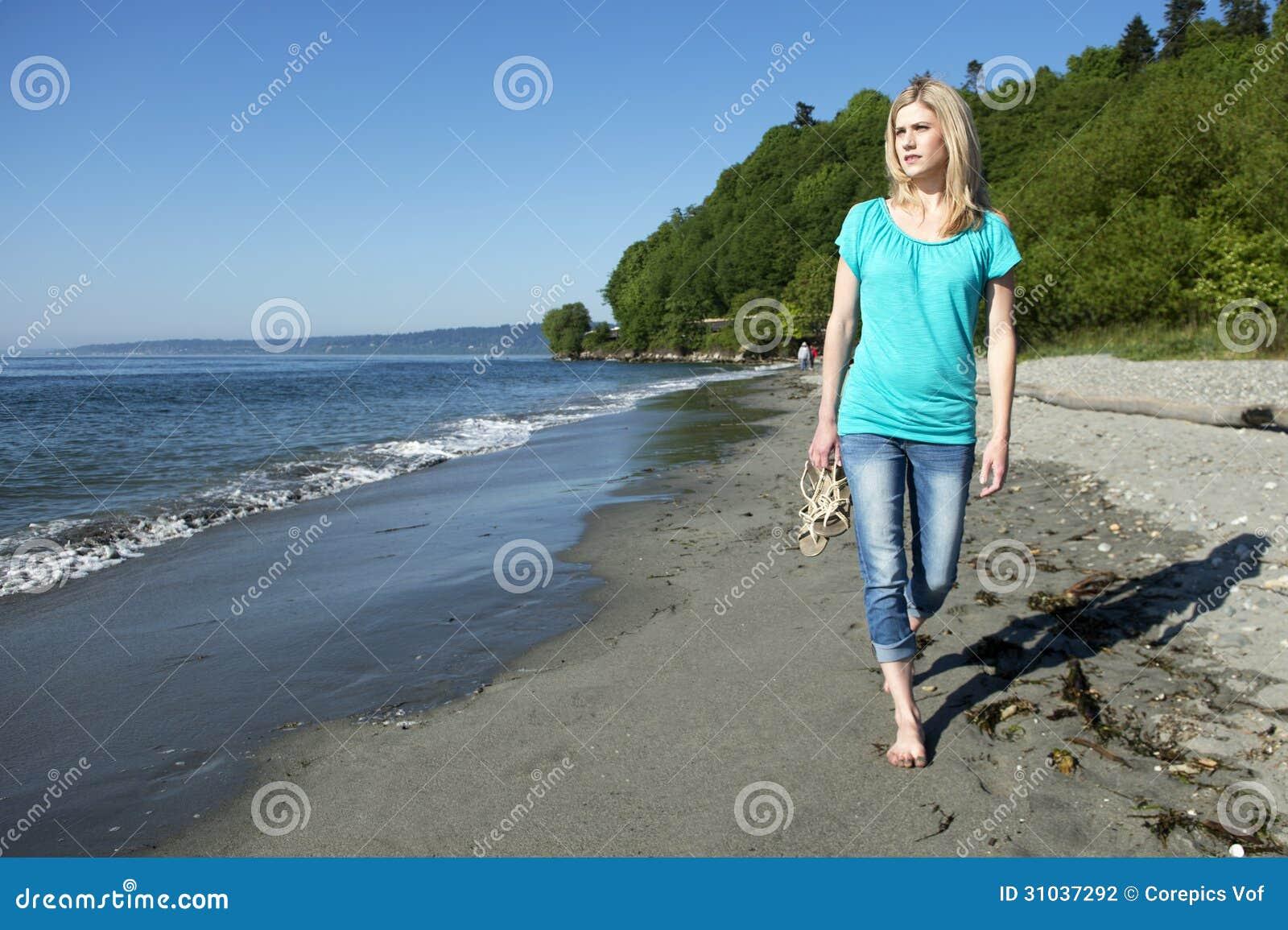 Woman Walking On Beach Stock Photography - Image: 31037292