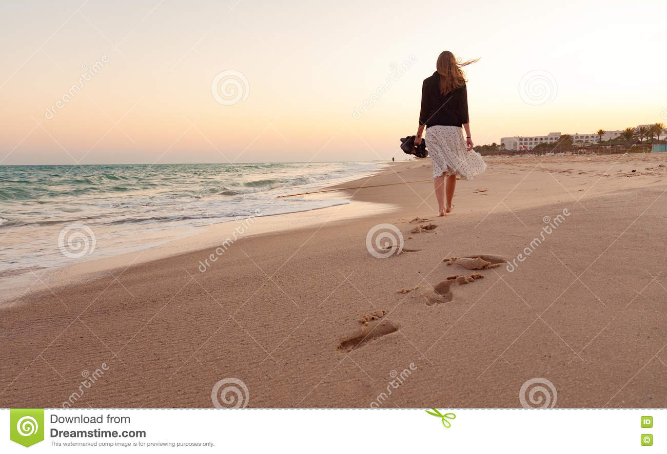 Woman walking on a beach royalty - Woman Walking Beach Sunset Royalty Free Stock Photo
