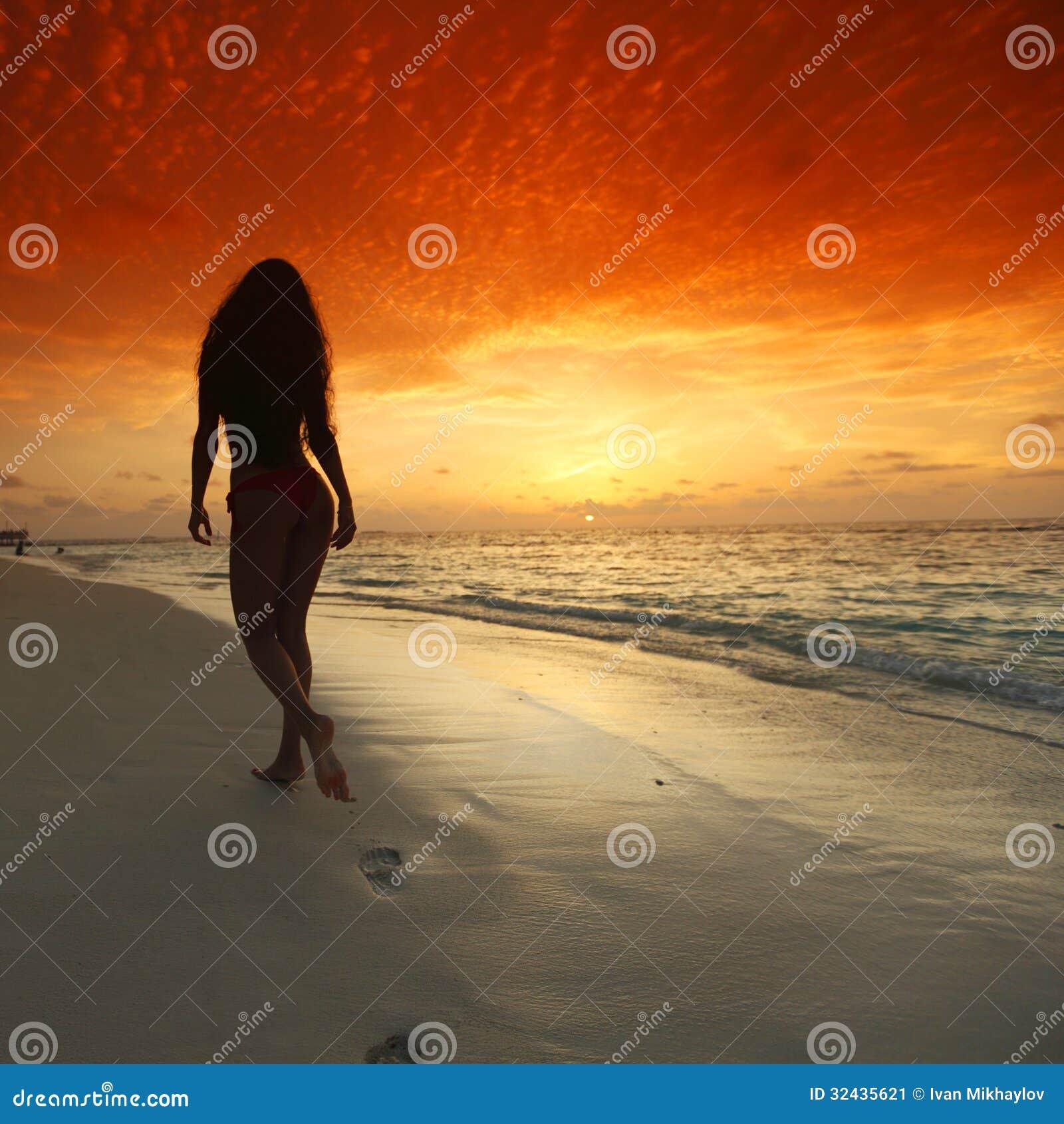 Beautiful Woman Face Over Beach Sunset Stock Image: Woman Walking On Beach Stock Image. Image Of People, Back