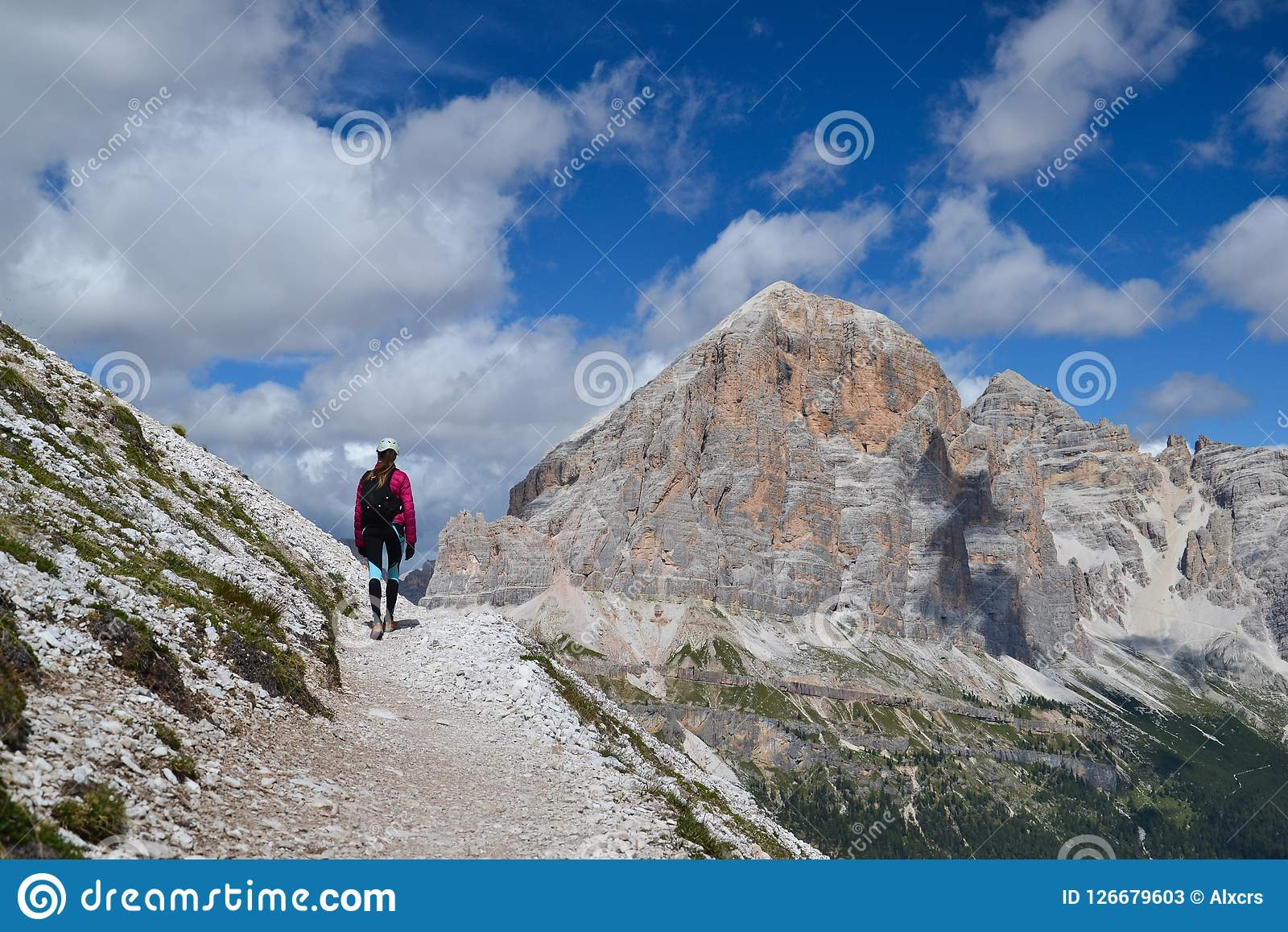 Woman walking in Dolomite mountains