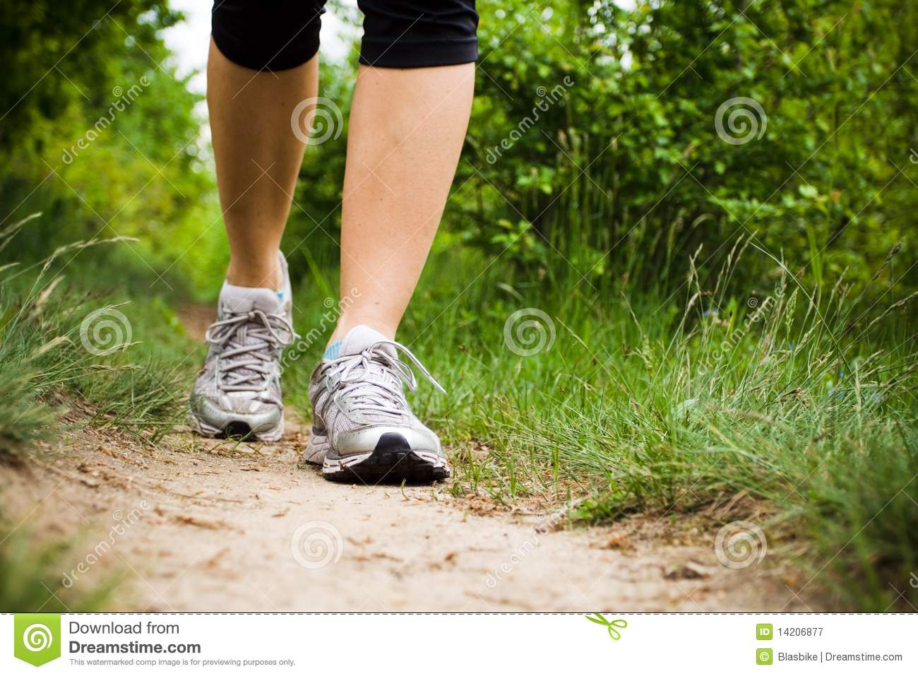 Woman walking in forest, sport shoes