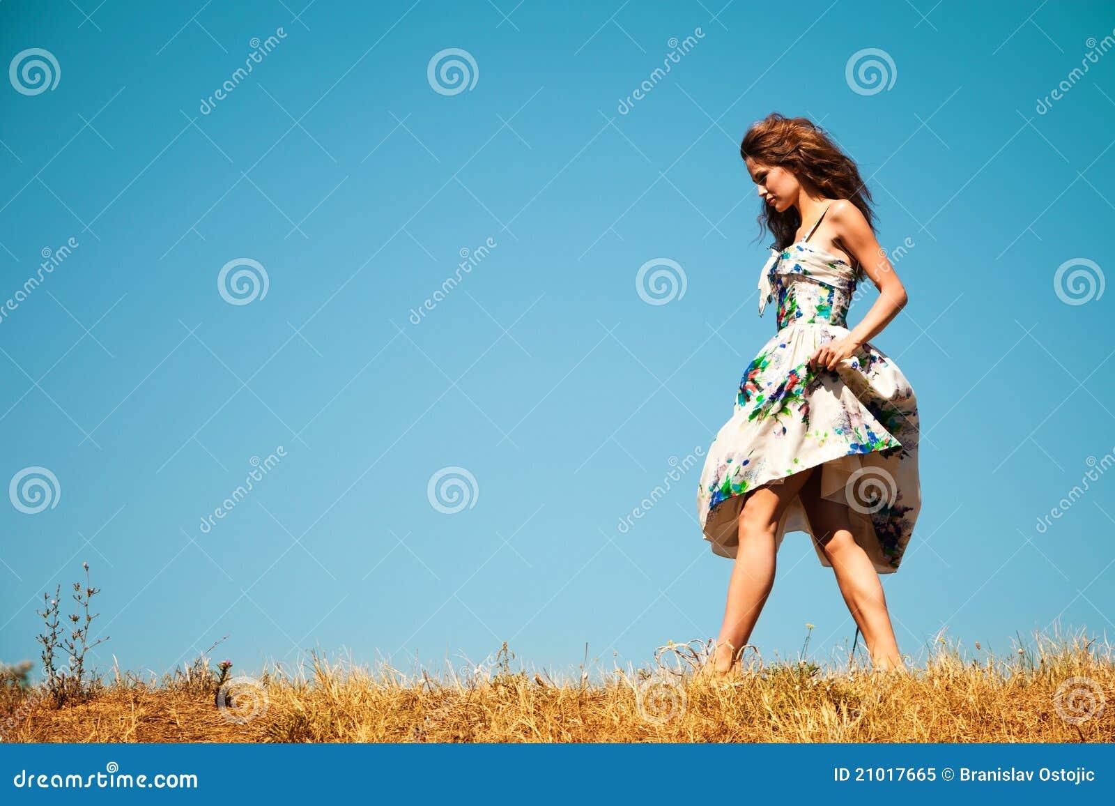 woman walking in grass - photo #3