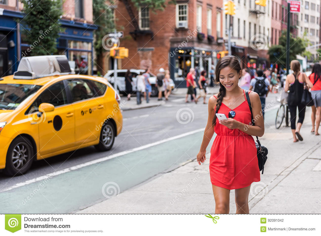 Woman walking in new york city using phone app