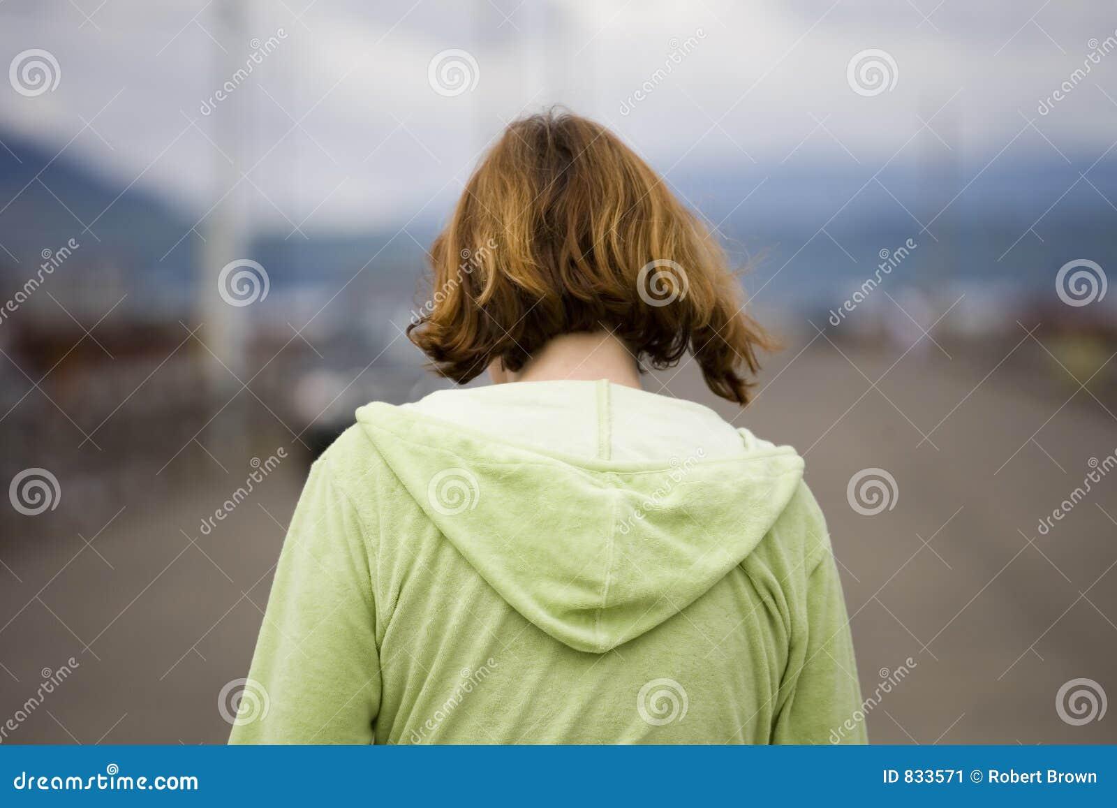 Woman Walking on a Pier