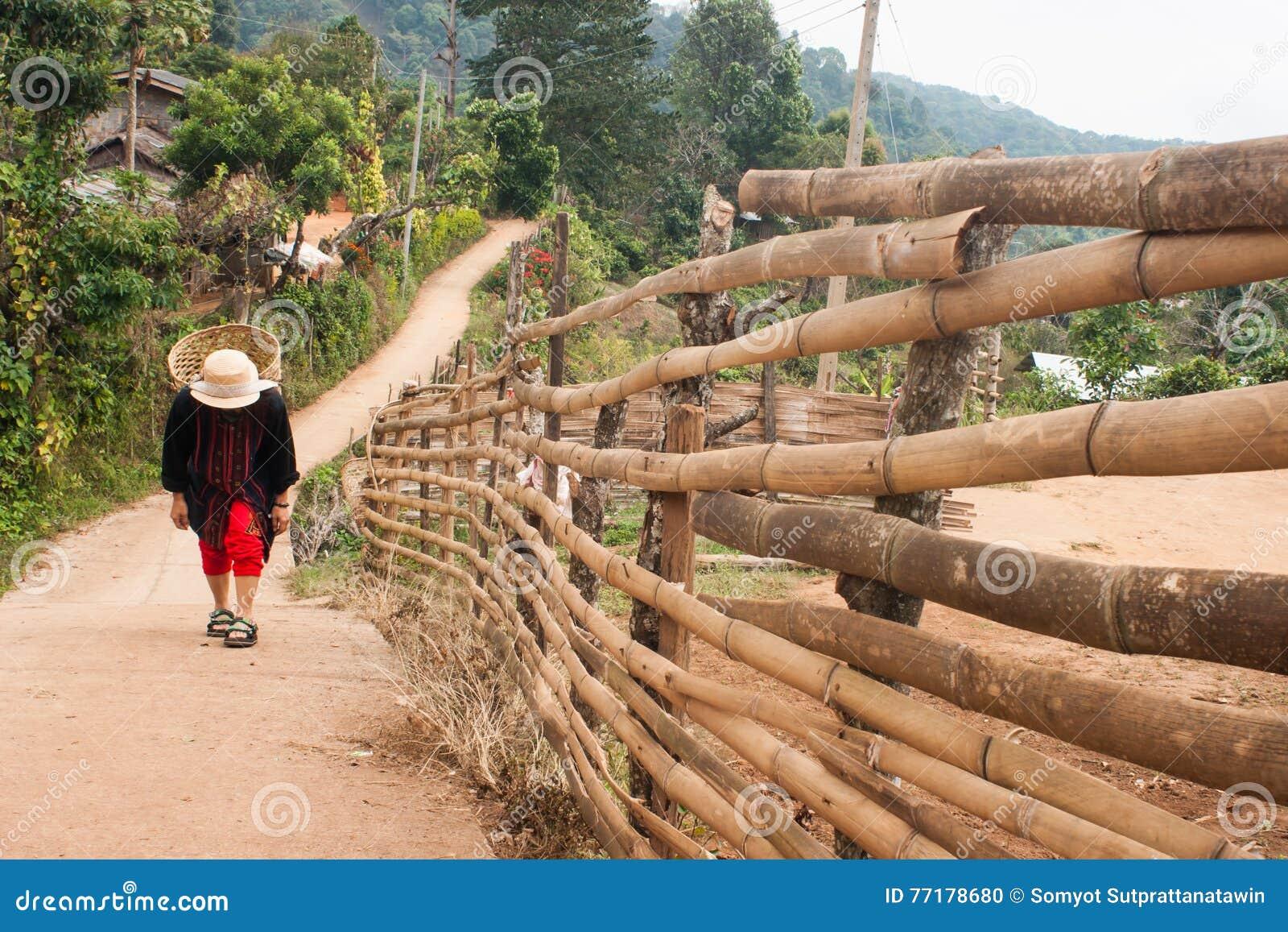Woman walking rural village