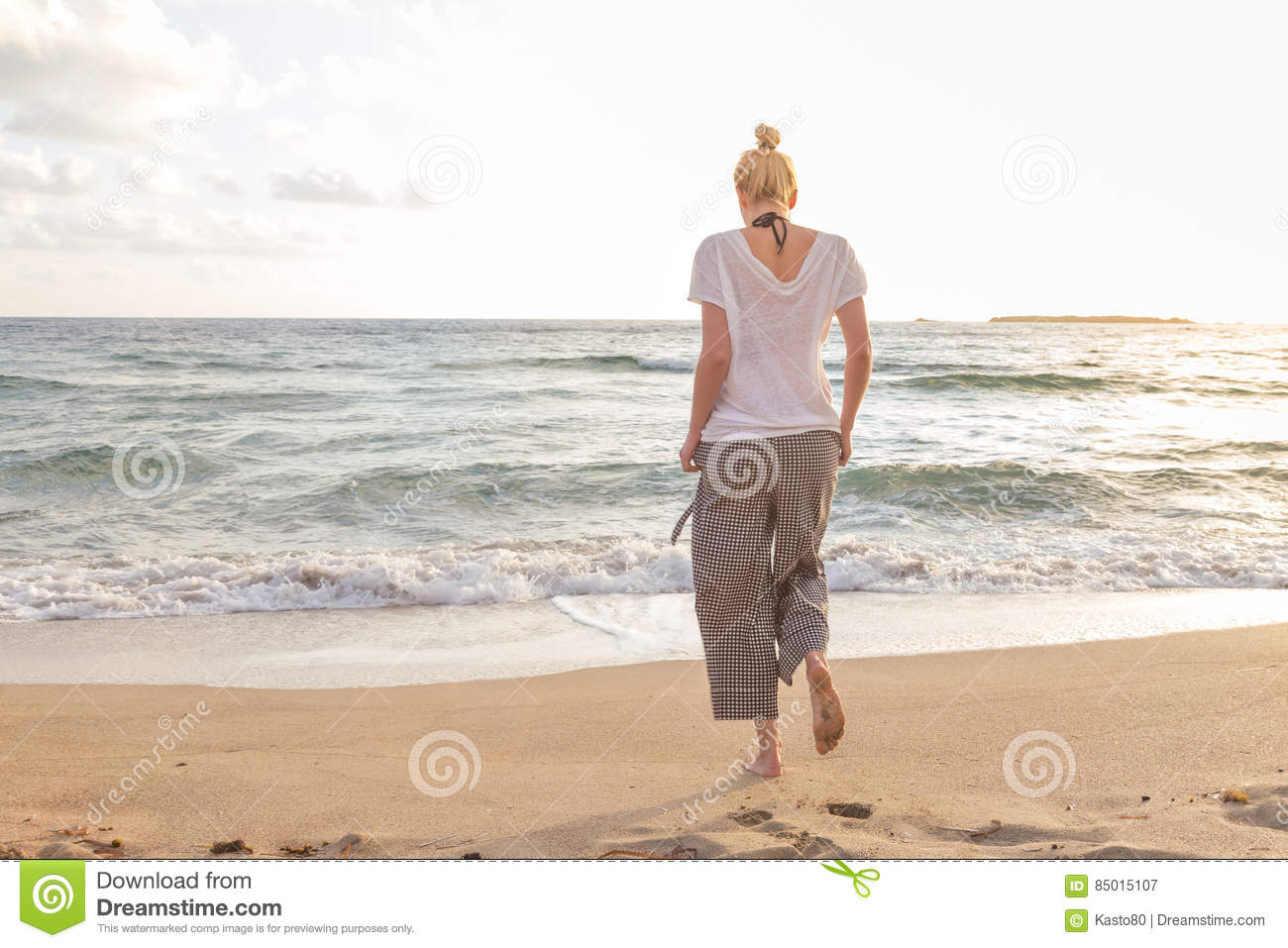 Woman Walking On Sand Beach At Golden Hour Stock Image - Image of ... b4b4cd2fdc6