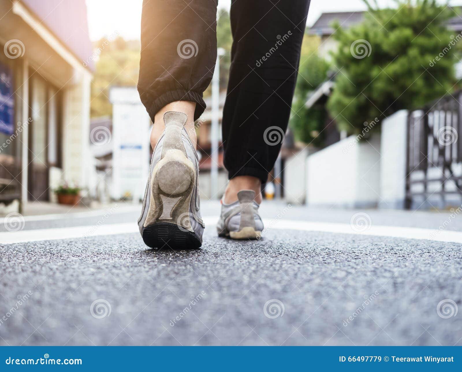 Woman Walking on Street Outdoor Urban in morning