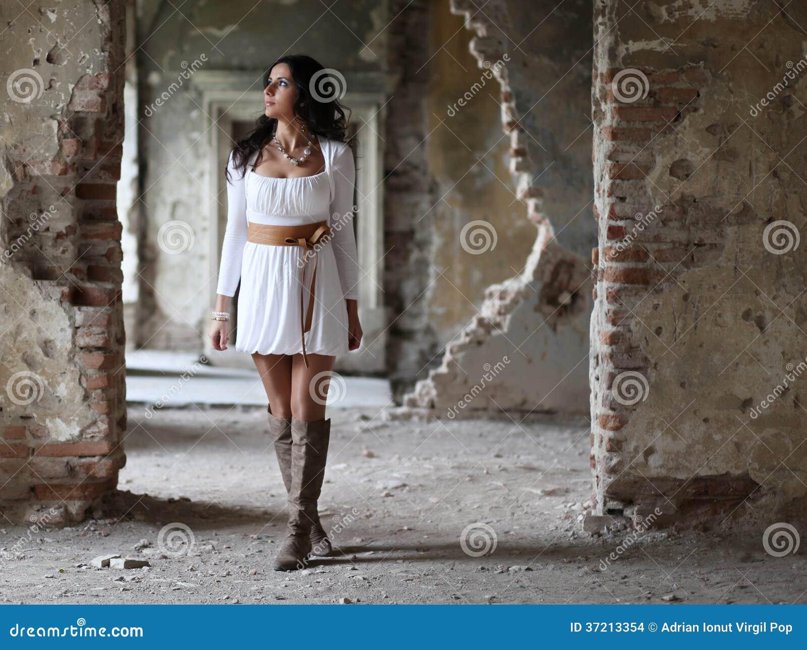 Woman Walking Trough Multiple Doors Stock Images