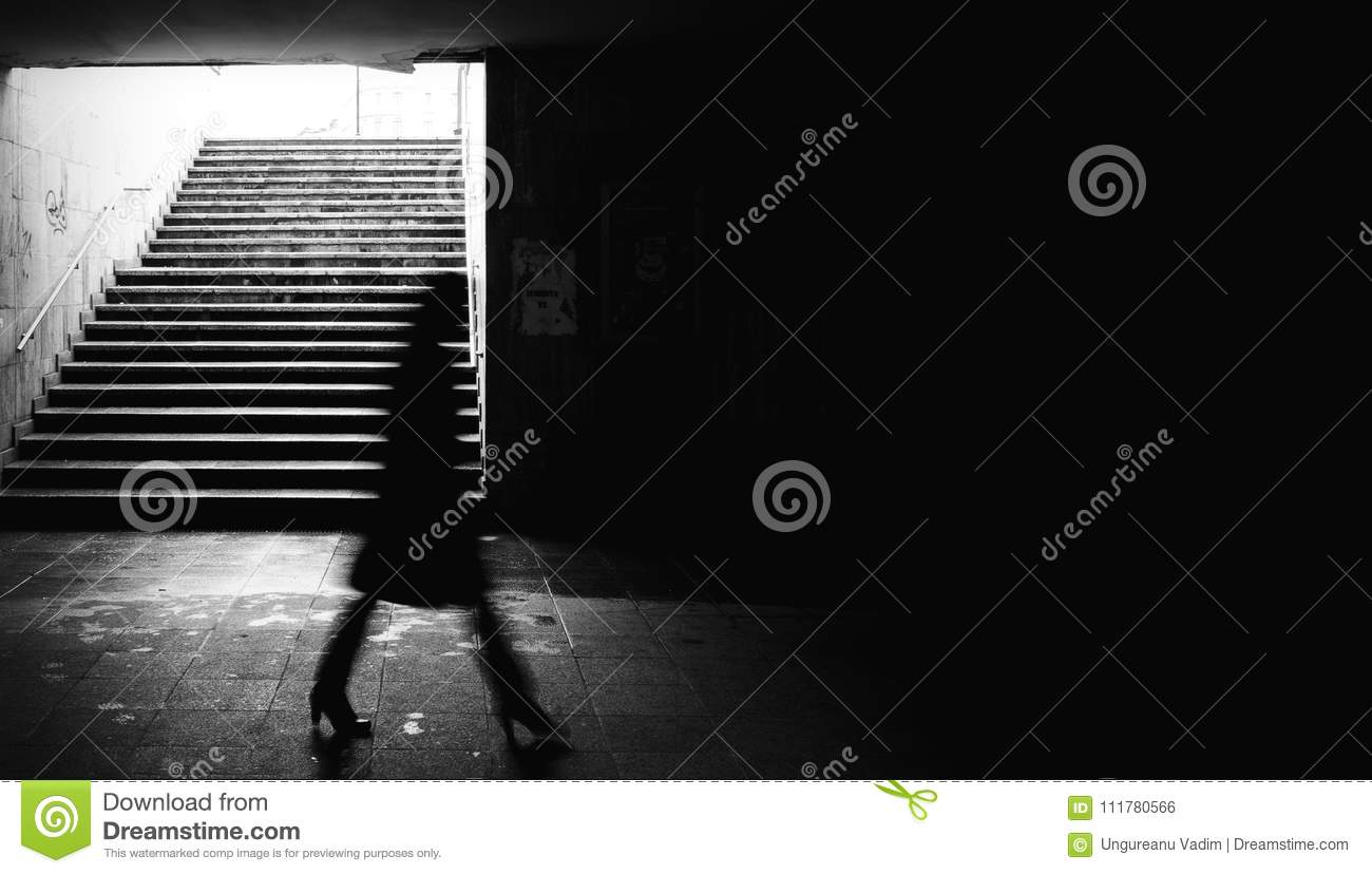 Woman walking in a underground passing