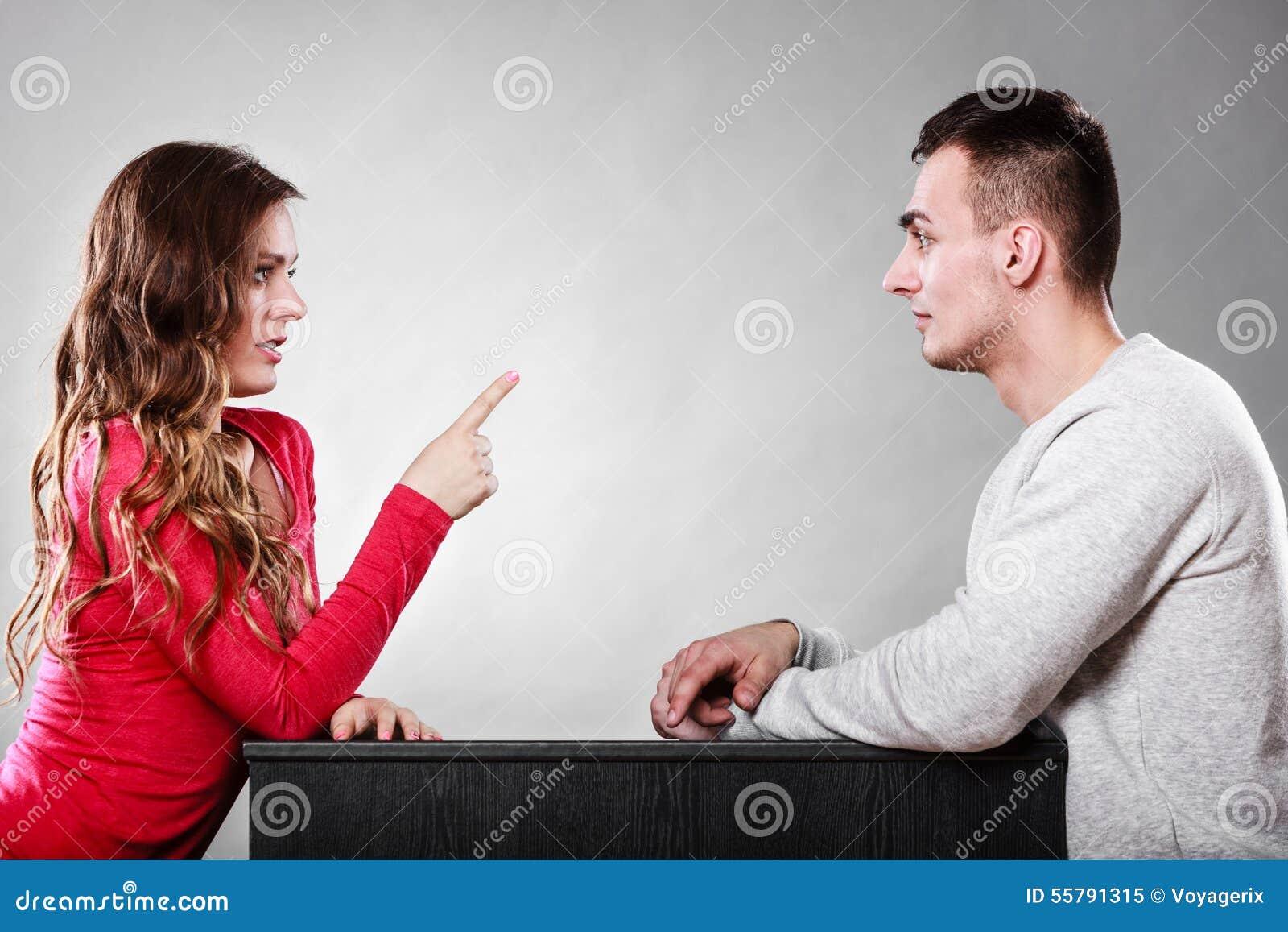 Woman warning man. Girl threatening with finger.