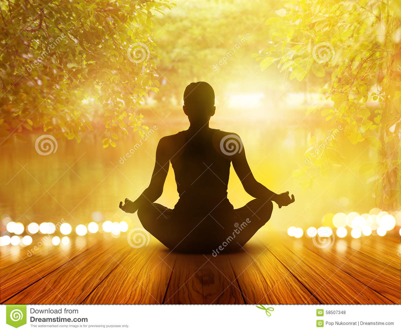 Woman was meditating in sunrise and rays of light on park and nature