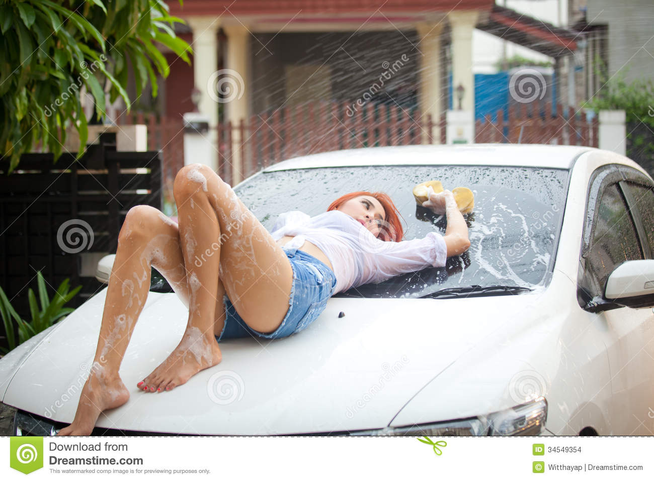 Woman washing a car