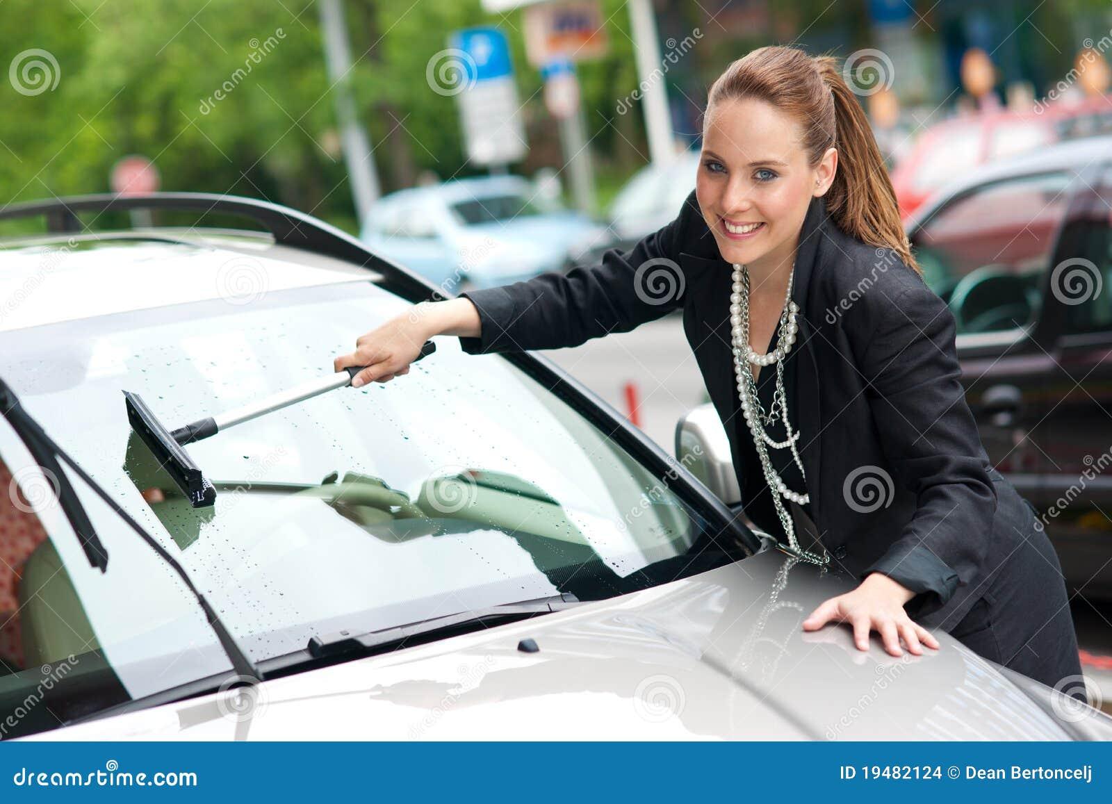 Woman washing car window stock photo image of lady - Como limpiar los cristales del coche ...