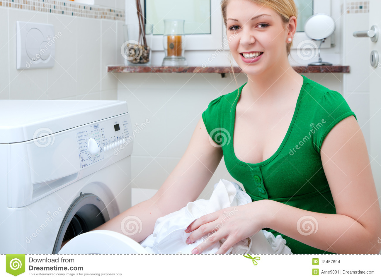 Washing Machine With Clothes ~ Woman washing clothes with machine stock photo image of
