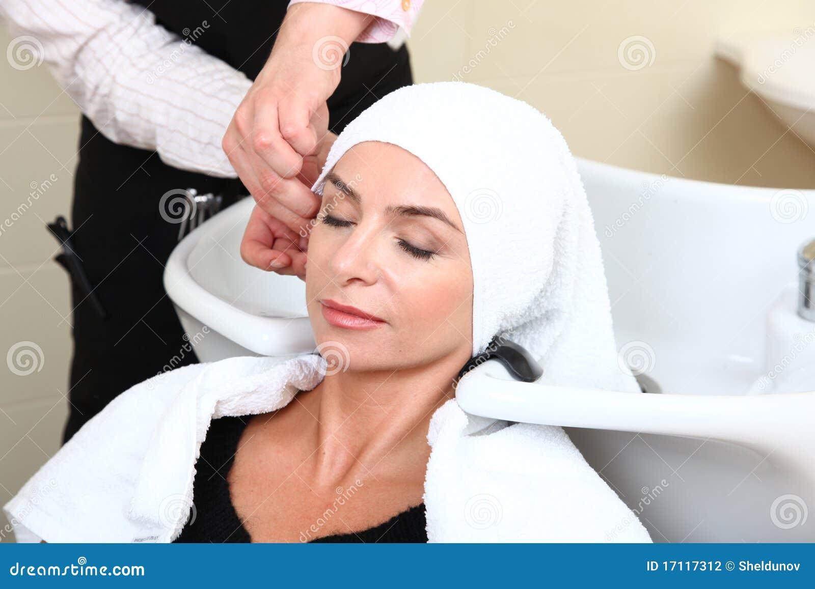 Woman washing hair in salon pool stock photo image 17117312 for Wash hair salon