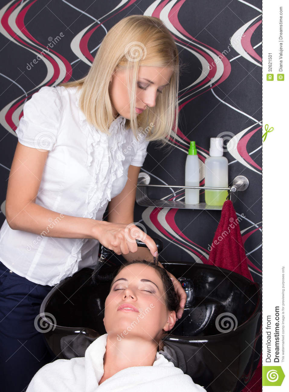 Woman washing hair in sink the image for Wash hair salon