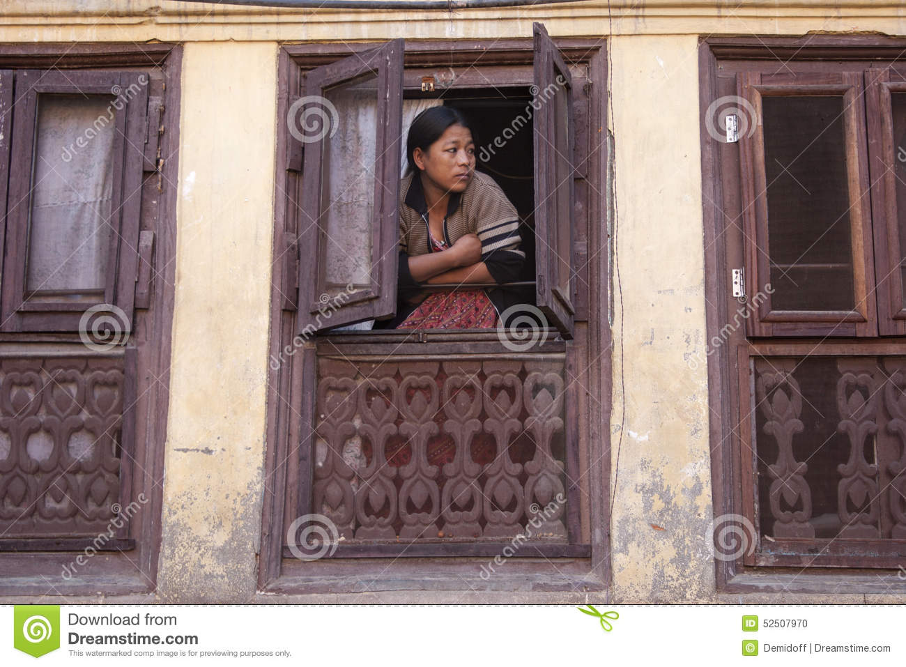 Woman watch from a window editorial image image 52507970 for Window design in nepal