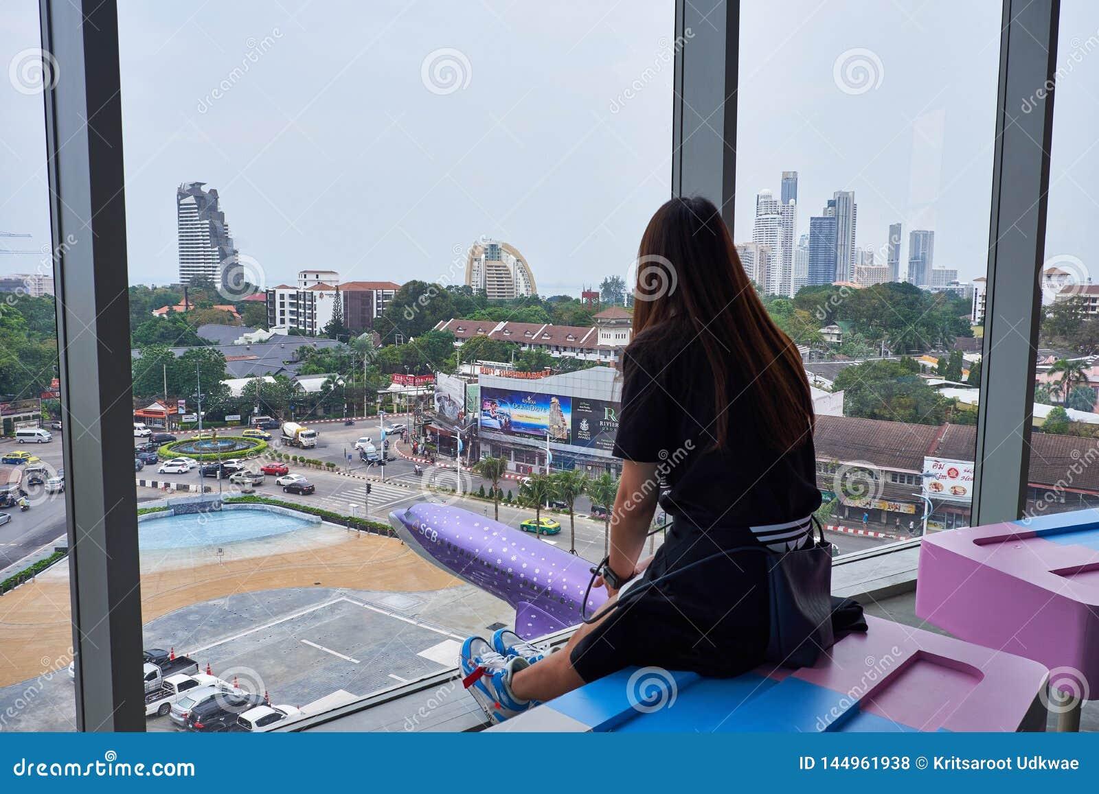A woman watching outside at Terminal 21 Pattaya